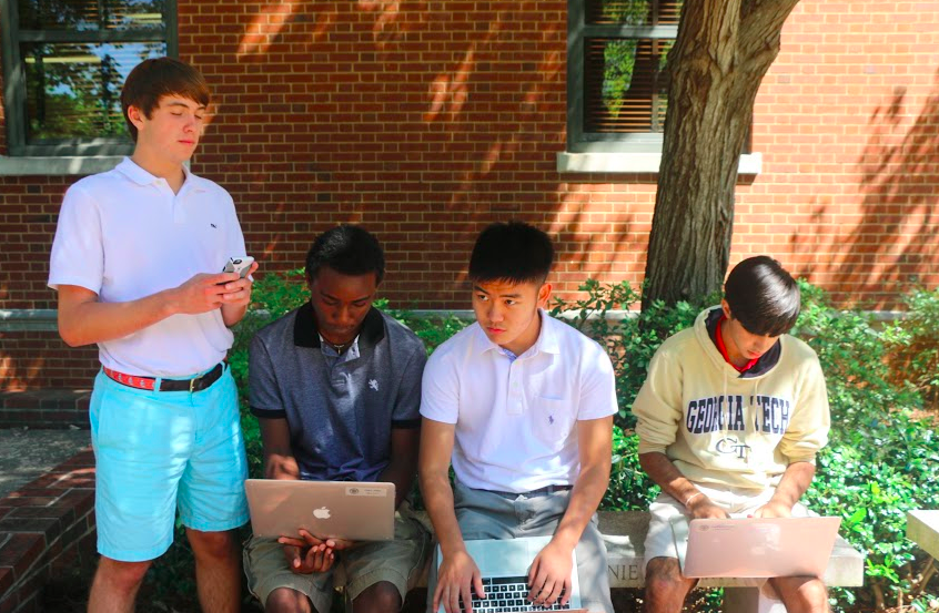 Juniors Colby Webb, Michael McGovern, David Choi and Ajay Manocha check their fantasy football stats.