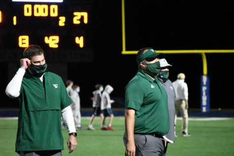 Westminster coaches get their game faces on in preparation for some Friday night football against St. Pius.  Photo courtesy Kelly Weselman.