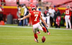Harrison Butker 13 in action punting for the Kansas City Chiefs.