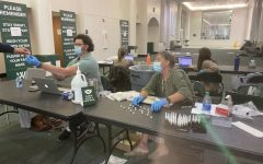Kelley and Tyler Day organize students' saliva samples during weekly testing.