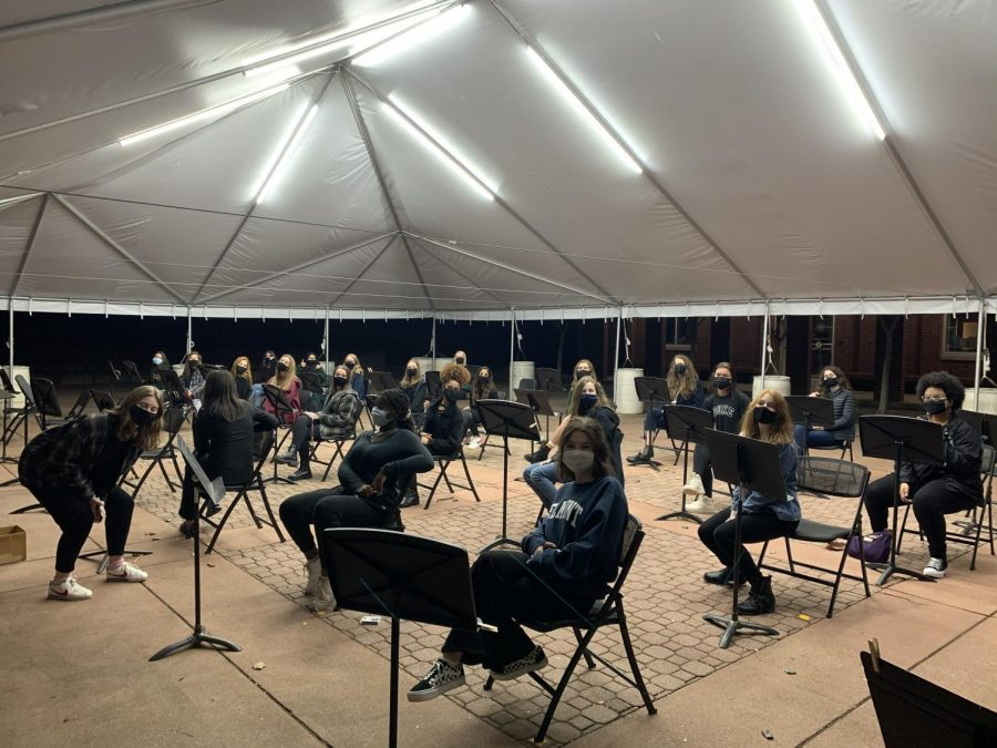 WAC hosts an evening rehearsal, socially distant, in the tent on Love Patio.