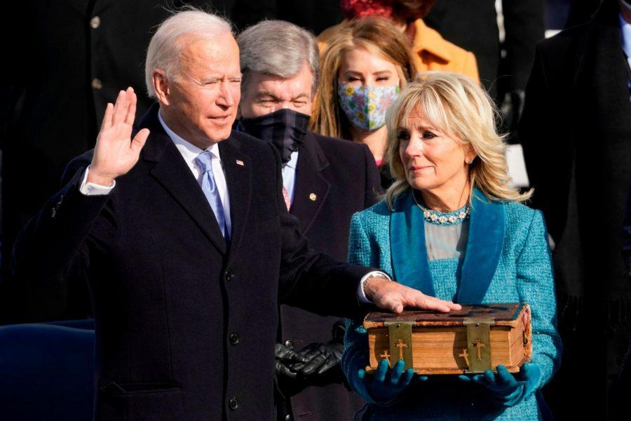 Joe Biden is sworn in alongside his wife Jill Biden. Source: Getty Images