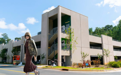 Wintour poses in front of newly constructed parking deck.