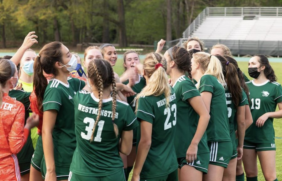 The+Varsity+Girls+soccer+team+huddles+up+before+a+game+to+get+in+the+winning+spirit.+